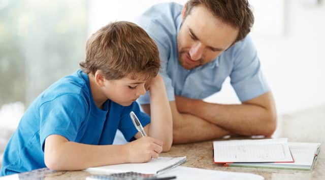 Man doing homework with a young boy