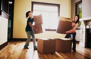 Mother and daughter stacking boxes