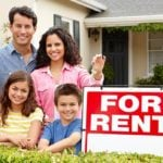 "Family with a ""For Rent"" sign"