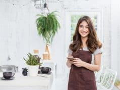 A young asian tan woman barista cafe owner