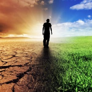 A man standing between ideal climate and drought