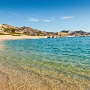 Beach and resorts on the sandy beach coastline of Los Cabos in Mexico